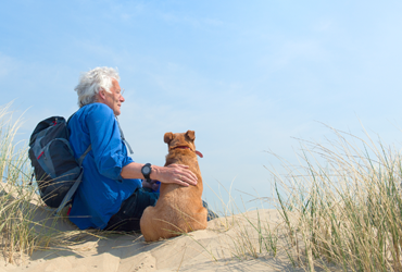 man_with_dog_at_beach